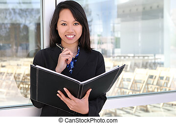 Asian Business Woman - A young, beautiful asian business...