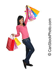 Excited young black woman with shopping bags - Young excited...