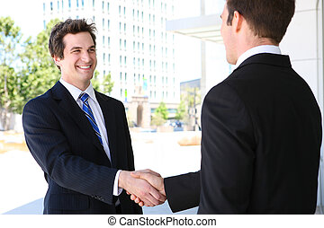Business Man Team Handshake - A business man team at office...