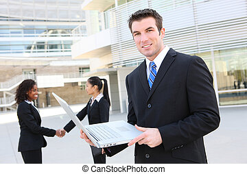 Business Man with Laptop - A handsome business man with...