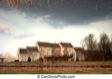 Enigma - A reflected house on the pond turned upside down