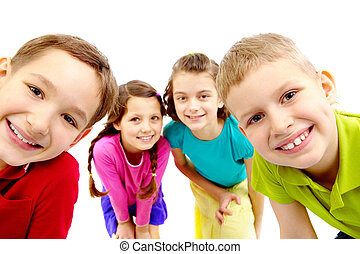 Group of children - Group of joyful children peeping into...