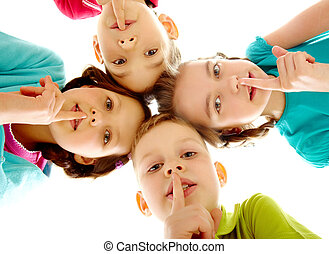 Shh - Group of children fingers on lips making silence