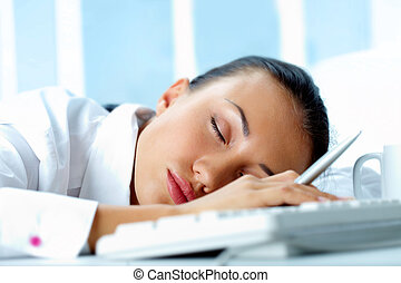 Silence - Image of young businesswoman sleeping on workplace...