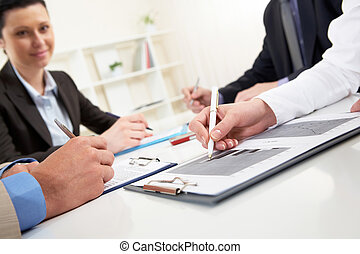 Signing agreement - Close-up of business person hand over...