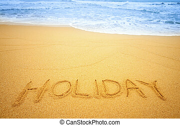 "Holiday on the beach - ""Holiday"" written in the sand on the..."