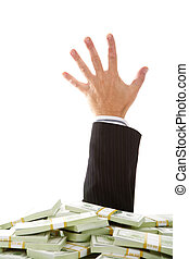 Stuck in money - A male hand stretching out of money heap