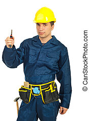 Constructor worker holding pincers - Young constructor...