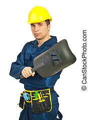 Welder man - Young welder man holding welding mask isolated...