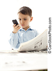 frowning young boy using mobile, isolated