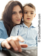 mother and son looking at monitor