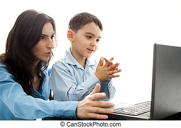 child claping hands in front of laptop