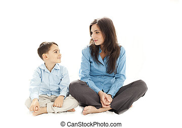 child and parent discussion - boy and his mother sitting and...