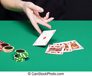 female hand with a winning card combinations