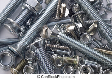 Bolts and screws - The large and small bolts and screws on a...