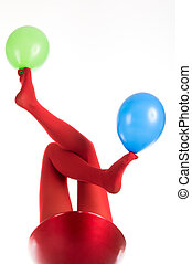 Female feet in red stockings with balloons isolated in white