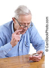 Senior man on the phone - Senior man figuring out how his...