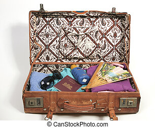 Open suitcase with vacation items - Vintage open suitcase...