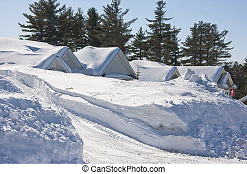 Snowbound - Two homes snowbound after a winter storm.