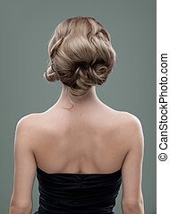 a head and shoulders image of a young woman, from the back...