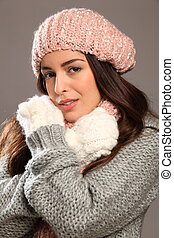 Young beauty warm in winter gear