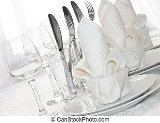 Tableware - Decoratively folded napkins with glasses,...