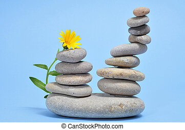 zen stones and flower - a pile of zen stones and flower on a...