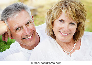 Mature couple smiling and embracing - Lifestyle portrait of...