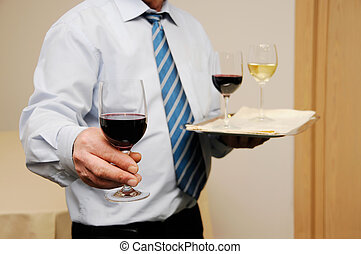 Waiter giving wine