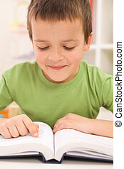 Boy practice reading at home