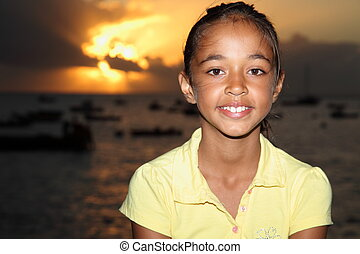 Girl with sunset in the background