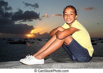Girl at seaside for sunset