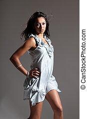 Beautiful girl in silver dress