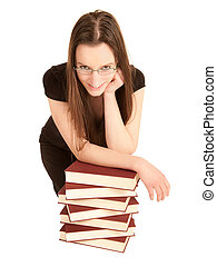 Young student with glasses and a pile of books - Beautiful...