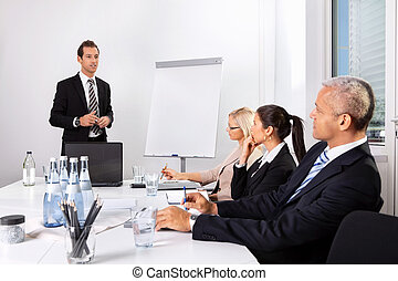 Businessman giving a presentation to his colleagues