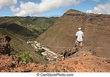 Hiker on trail on St Helena Island - Hiker stopping to...