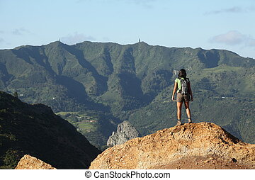 Hiker viewing peaks on St Helena - Female hiker standing on...