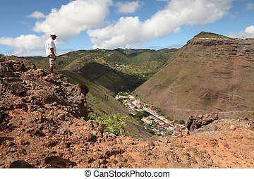 Walking the hills of St Helena - Walker stopping to admire...