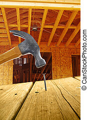 New home construction, with hammer and nail