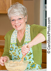 Grandma baking cookies - a friendly Grandma with white hair...
