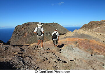 Man and woman hiking in mountain - Couple hiking on top...
