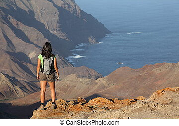 Hiker on top volcanic craters - Female hiker standing on top...