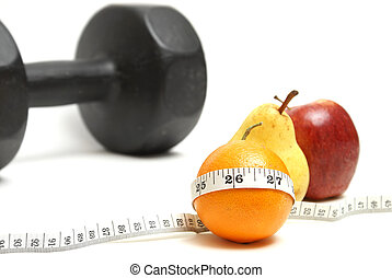 Fitness Concept - A few pieces of fruit with a measuring...