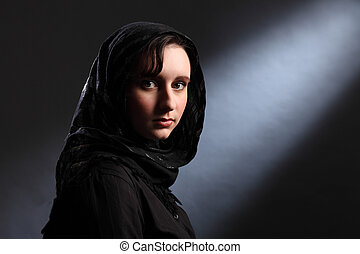Young muslim woman in hijab has quiet moment - Beautiful...