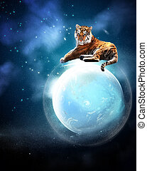 The Tiger - a tiger is sitting protectively on a planet