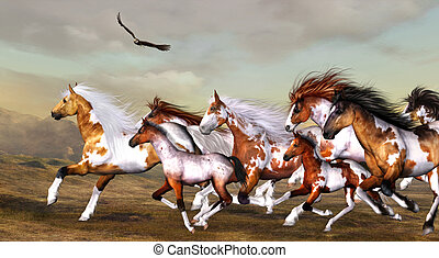 Wildhorses herd - a wild herd of horses galloping across the...