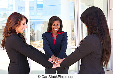 Business Woman Teamwork - A pretty diverse young business...