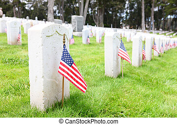 Cemetery Memorial - American flags on tombstones in cemetery...