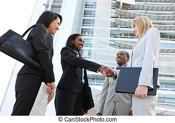 Diverse Business Team Handshake - A diverse business man and...