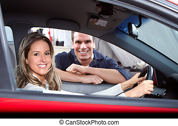 Auto mechanic - Handsome mechanic and woman in auto repair...